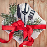 Christmas cutlery and fir tree on a wooden background Royalty Free Stock Photos