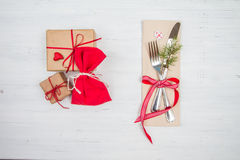 Christmas cutlery and holiday gifts on white table Royalty Free Stock Image