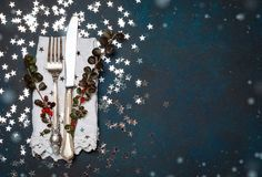 Christmas cutlery and table place setting, holidays copy space fairy light toning background Royalty Free Stock Images