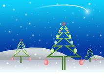 Christmas d. Christmas ornaments hung on trees to landscape in the background Stock Image
