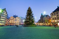 Christmas on the Damsquare in Amsterdam in the Netherlands. At night Stock Photos