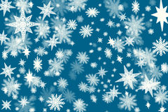 Christmas dark blue background with a lots of snow flakes and st Royalty Free Stock Image