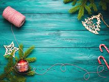 Christmas dark green wooden background. With green branches and decorations Stock Image