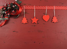 Christmas  dark red vintage recycled wood background with hanging wood ornaments - horizontal Royalty Free Stock Photo