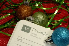 Christmas Day. Photo of a Calendar Open To Christmas Day - Christmas Related Royalty Free Stock Photos