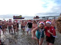 Christmas Day Bathers at Exmouth Devon UK. A tradition in the coastal resort of Exmouth in England is that at 11am each year on Christmas morning swimmers plunge Stock Photo