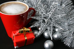 Christmas Day Coffee. Christmas morning foam coffee with silver decorations Stock Image