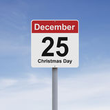 Christmas Day. Conceptual road sign indicating December 25 Royalty Free Stock Photos