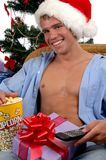 Christmas Day Games. A handsome young man in a Santa hat watching the games on Christmas Day Stock Photography