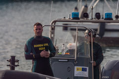 CHRISTMAS DAY HARBOUR SWIM 2015, BARCELONA, Port Vell - 25th December:Lifesavers watched for competitors Royalty Free Stock Photos