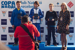 CHRISTMAS DAY HARBOUR SWIM 2015, BARCELONA, Port Vell - 25th December: winners of contest with trophies Stock Photo