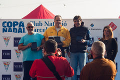CHRISTMAS DAY HARBOUR SWIM 2015, BARCELONA, Port Vell - 25th December: winners of contest with trophies Stock Photography