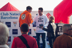CHRISTMAS DAY HARBOUR SWIM 2015, BARCELONA, Port Vell - 25th December: winners of contest with trophies Royalty Free Stock Photos