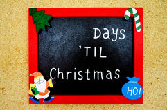 Christmas Days Remaining Frame. A picture frame hanging on a wall with the words days til Christmas on it. The number of days remaining until Christmas is royalty free stock photos