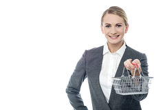 Christmas deals online, add to cart!. Woman holding shopping cart, e-commerce concept Royalty Free Stock Image