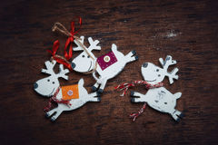 Christmas decaradio sets. Cheerful deer run against a dark background. Royalty Free Stock Image