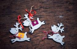 Christmas decaradio sets. Cheerful deer run against a dark background. Royalty Free Stock Images
