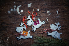 Christmas decaradio sets. Cheerful deer run against a dark background. Royalty Free Stock Photo