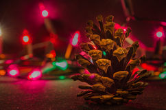 Christmas Deco. Pine cone and lights decoration photo Royalty Free Stock Images