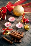 Christmas decor background with candles and cinamon stock photos