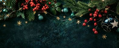 Christmas decor background with place for text. Christmas background with a festive decor, fir tree and place for text stock photo