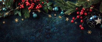 Christmas decor background with place for text. Christmas background with a festive decor, fir tree and place for text royalty free stock image