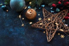 Christmas decor background with place for text. Christmas background with a festive decor, fir tree and place for text royalty free stock images