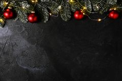 Christmas decor on black wall Royalty Free Stock Images