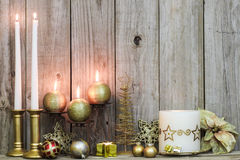 Christmas decor and candles by wood background Stock Photos
