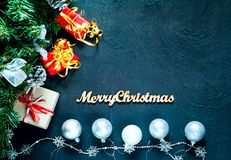 Christmas decor.Celebratory background with Christmas gift boxes and silvery balls on blue concrete background, top view,concept royalty free stock image