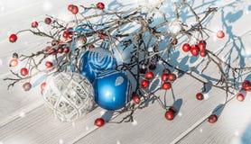 Christmas decor. Christmas balls and berries of hawthorn Stock Photo