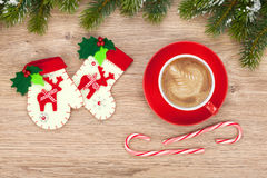 Christmas decor and coffee cup. Over wooden table background Royalty Free Stock Photos