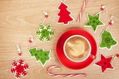 Christmas decor and coffee cup over wooden table background Stock Photo