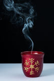 Christmas decor. Christmas colored candle with flame off and smoke Royalty Free Stock Images