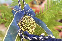 Decorative Christmas pomegranate with blue ribbons Royalty Free Stock Photography