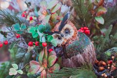 Christmas decor. Eagle owl sitting on branches. royalty free stock photos