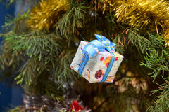 Christmas Decor on Gift Box, ribbons and fir tree. Celebration theme with christmas gifts Stock Photos