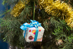 Christmas Decor on Gift Box, ribbons and fir tree. Celebration theme with christmas gifts Royalty Free Stock Photos