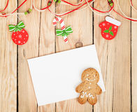 Christmas decor, gingerbread cookie and card for copy space. On wooden table royalty free stock photo