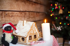 Christmas decor: gingerbread house. New year candle Royalty Free Stock Images