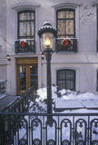 Christmas decor on historic home after winter snowstorm in Manhattan, New York City, NY Stock Images