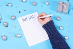Christmas decor and letter to Santa on blue background royalty free stock photo