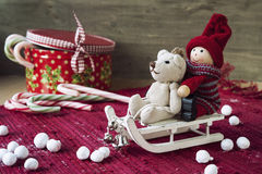Christmas decor - miniature toys on sledges. Gift box with candi Royalty Free Stock Images