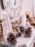 Christmas decor, New Year`s card scenery, New Year Clock with candles and photoframe. New Year concept. royalty free stock images