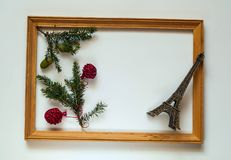 Christmas decor. New Years wooden frame with spruce branches and eiffel tower on white background,copy space, closeup, flat lay. Isolated Royalty Free Stock Photography