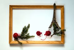 Christmas decor. New Years wooden frame with spruce branches and eiffel tower on white background,copy space, closeup, flat lay. Isolated Royalty Free Stock Photos