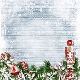 Christmas decor with a nutcracker and candy cane. with firtree o. Christmas card with nutcracker, candy, firtree, holly on a holiday background Stock Image