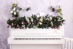 Christmas decor on the piano stock images