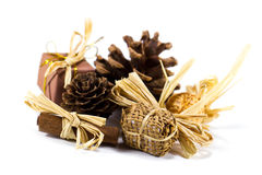Christmas decor with pine cones, cinnamon and sweets Stock Photos