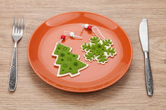 Christmas decor on plate and silverware Stock Image